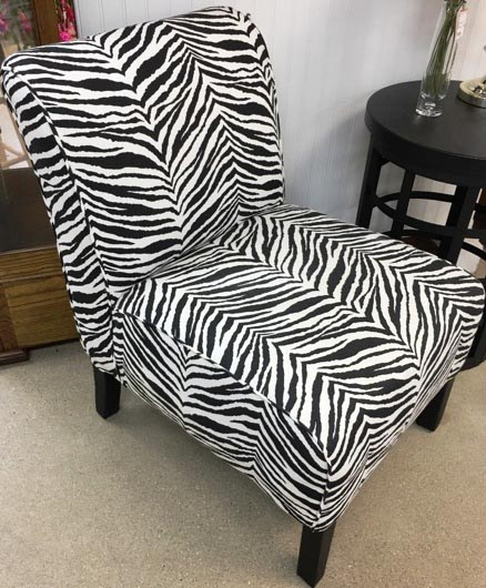 Zebra print cushioned chair